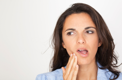 Patient with tooth pain at Rai Oral Surgery & Dental Implants